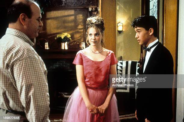 Larry Miller stands before Larisa Oleynik and Joseph GordonLevitt in a scene from the film '10 Things I Hate About You' 1999