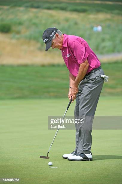 Larry Mize hits a putt on the 17th green during the first round of the PGA TOUR Champions Constellation SENIOR PLAYERS Championship at Caves Valley...