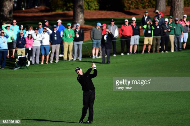 Larry Mize of the United States plays a shot on the first hole during the first round of the 2017 Masters Tournament at Augusta National Golf Club on...