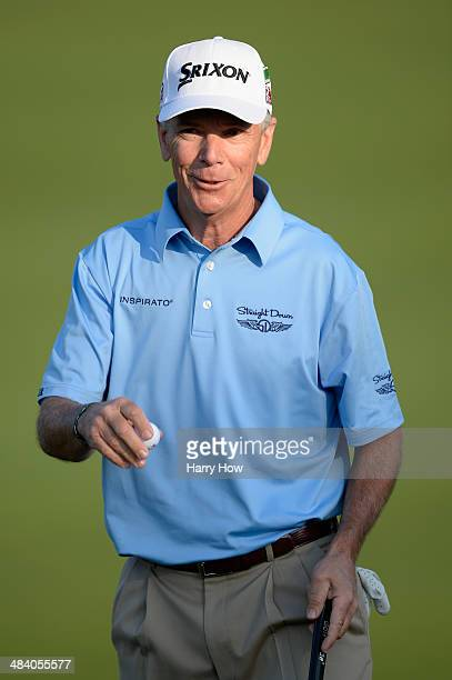 Larry Mize of the United States reacts after hitting a putt on the second green during the second round of the 2014 Masters Tournament at Augusta...