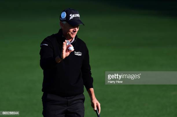 Larry Mize of the United States reacts to making par on the second hole during the first round of the 2017 Masters Tournament at Augusta National...
