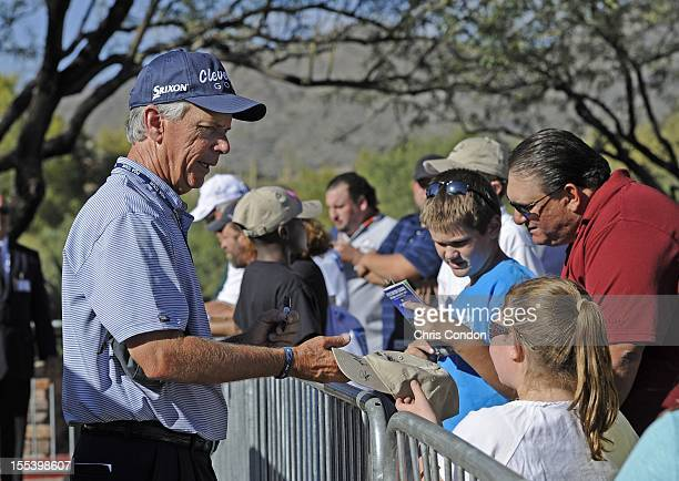 Larry Mize signs autographs for fans during the third round of the Charles Schwab Cup Championship at Desert Mountain Club on November 3 2012 in...