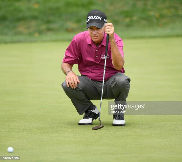 Larry Mize studies his putt on the 16th green during the first round of the PGA TOUR Champions Constellation SENIOR PLAYERS Championship at Caves...