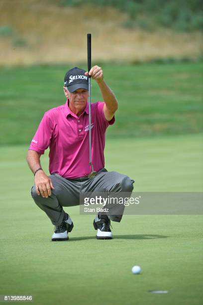 Larry Mize studies his putt on the 17th green during the first round of the PGA TOUR Champions Constellation SENIOR PLAYERS Championship at Caves...