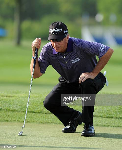 Larry Mize studies his putt on the first hole during the final round of the Legends Division at the Liberty Mutual Insurance Legends of Golf at The...
