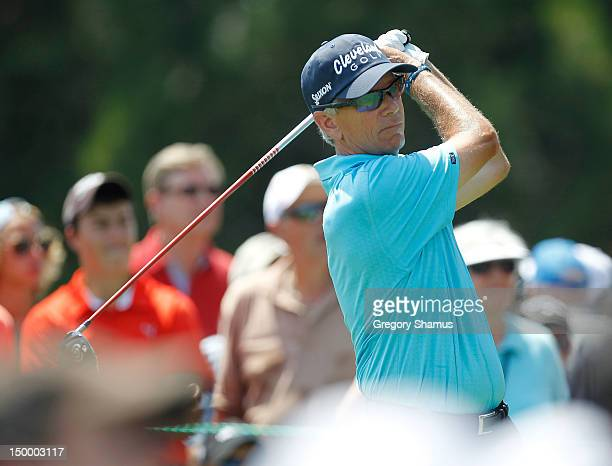 Larry Mize watches his tee shot on the 15th hole during the second round of the 2012 Senior United States Open at Indianwood Golf and Country Club on...