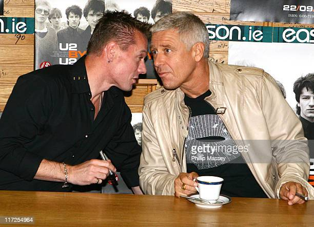Larry Mullen and Adam Clayton during U2 Book Signing and Photocall September 22 2006 at Eathan's Bookstore in Dublin Great Britain