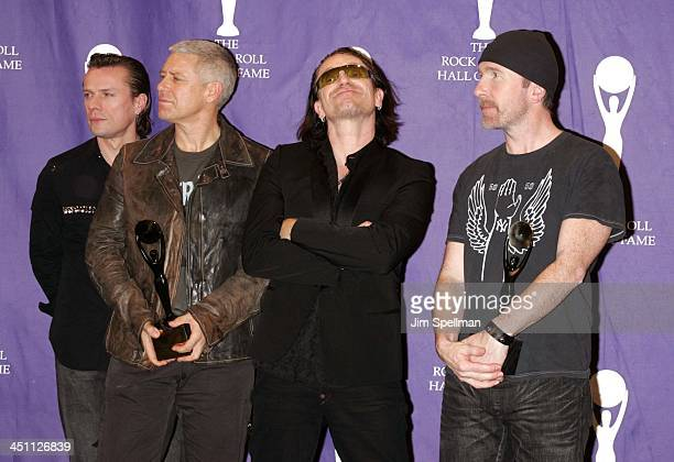 Larry Mullen Jr Adam Clayton Bono and The Edge of U2 inductees