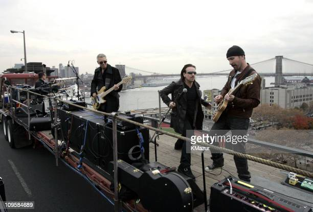 Larry Mullen Jr Adam Clayton Bono and the Edge of U2 spend the day on the streets of New York City shooting a video for their new album 'How to...