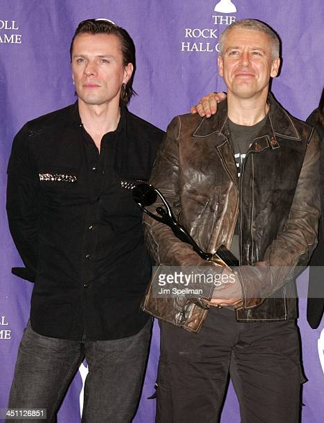 Larry Mullen Jr and Adam Clayton of U2 inductees