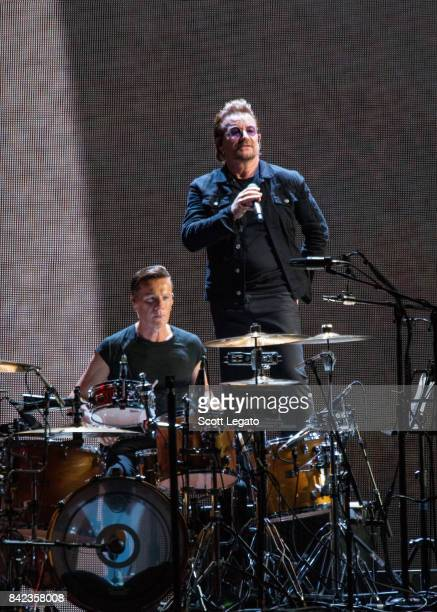Larry Mullen Jr and Bono of U2 perform during 'The Joshua Tree Tour 2017' at Ford Field on September 3 2017 in Detroit Michigan