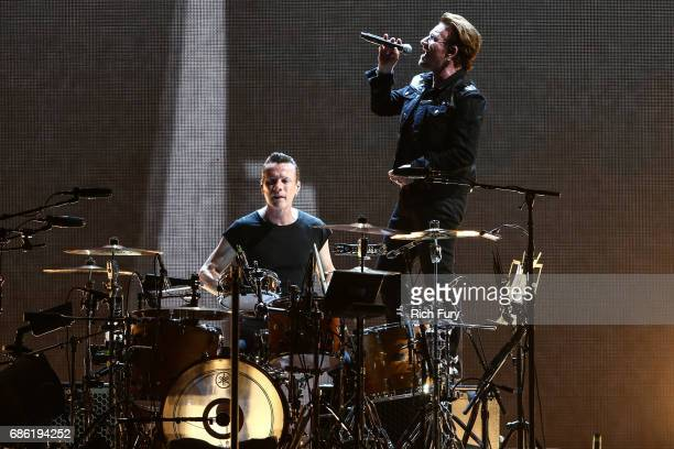 Larry Mullen Jr and Bono of U2 perform onstage at the Rose Bowl on May 20 2017 in Pasadena California
