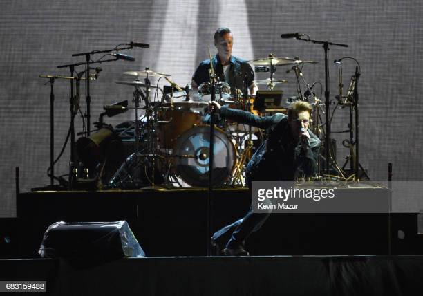 Larry Mullen Jr and Bono perform onstage during U2 'Joshua Tree Tour 2017' at CenturyLink Field on May 14 2017 in Seattle Washington