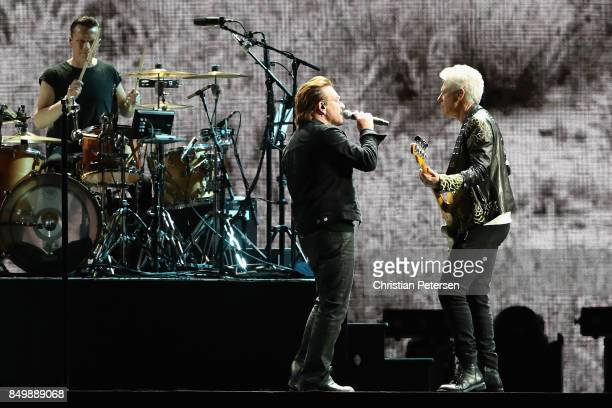 Larry Mullen Jr Bono and Adam Clayton of U2 perform during The Joshua Tree Tour 2017 at University of Phoenix Stadium on September 19 2017 in...