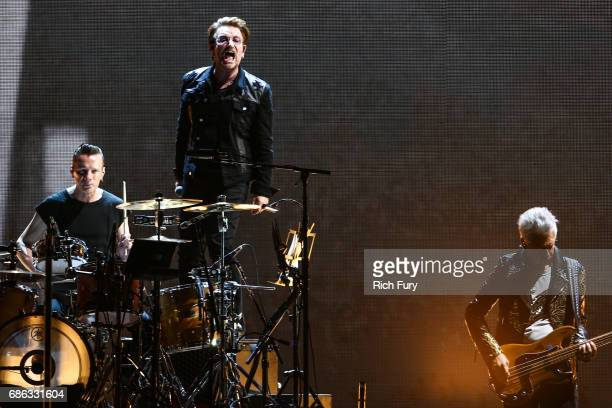 Larry Mullen Jr Bono and Adam Clayton of U2 perform onstage at the Rose Bowl on May 20 2017 in Pasadena California
