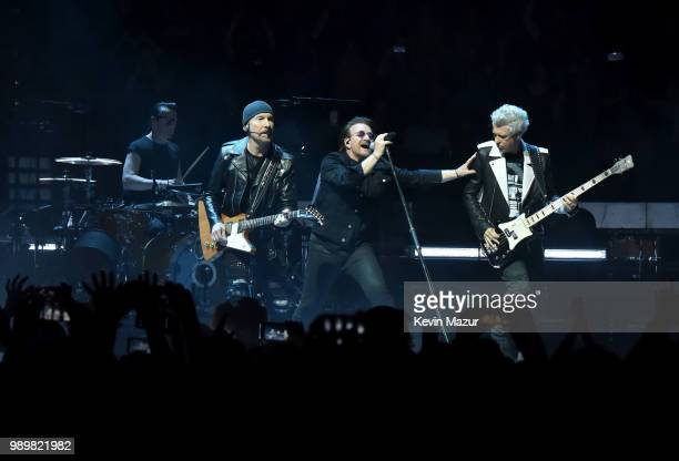 Larry Mullen Jr The Edge Bono and Adam Clayton of U2 perform on stage during the eXPERIENCE iNNOCENCE tour at Madison Square Garden on July 1 2018 in...