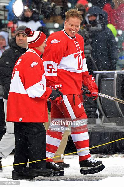 Larry Murphy of the Detroit Red Wings walks with former Red Wing Ted Lindsay to the ice before a game against the Toronto Maple Leafs during the 2013...