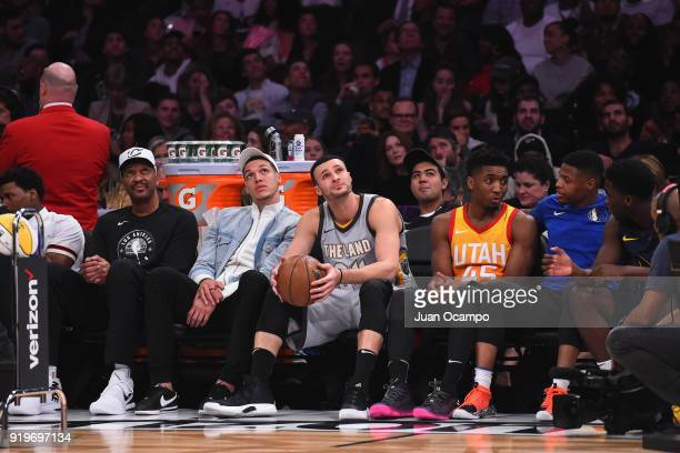 Larry Nance Aaron Gordon of the Orlando Magic Larry Nance Jr #24 of the Cleveland Cavaliers and Donovan Mitchell of the Utah Jazz sit on the bench...