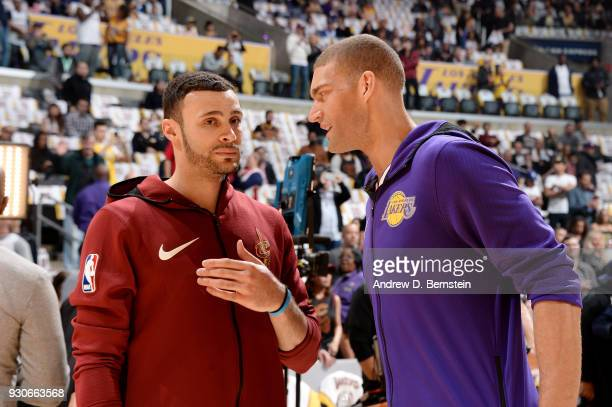 Larry Nance Jr #22 of the Cleveland Cavaliers and Brook Lopez of the Los Angeles Lakers talk before the game on March 11 2018 at STAPLES Center in...