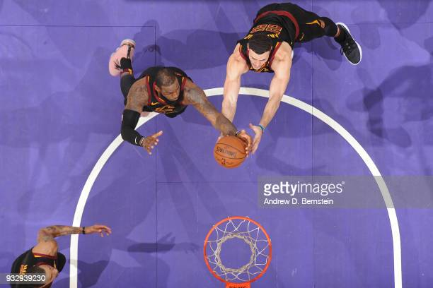 Larry Nance Jr #22 of the Cleveland Cavaliers and LeBron James of the Cleveland Cavaliers reach for the ball during the game against the Los Angeles...