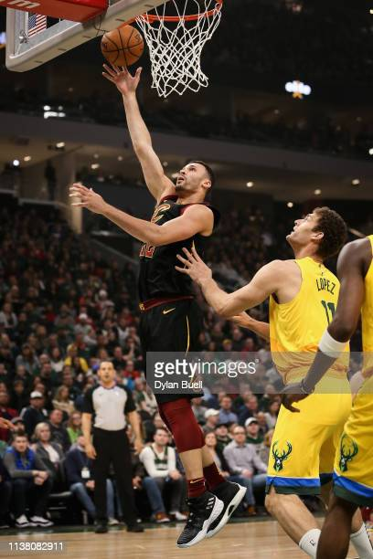 Larry Nance Jr #22 of the Cleveland Cavaliers attempts a shot while being guarded by Brook Lopez of the Milwaukee Bucks in the first quarter at the...