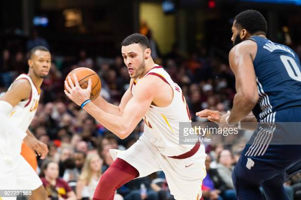 Larry Nance Jr #22 of the Cleveland Cavaliers drives around Andre Drummond of the Detroit Pistons during the second half at Quicken Loans Arena on...