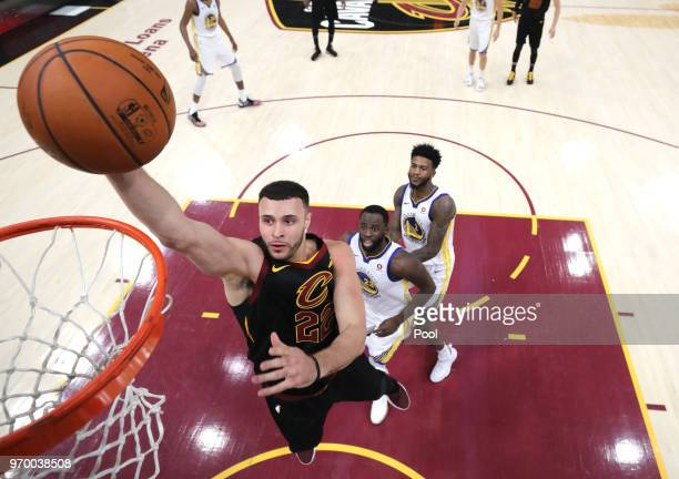 Larry Nance Jr #22 of the Cleveland Cavaliers drives to the basket in the first half against Draymond Green of the Golden State Warriors during Game...