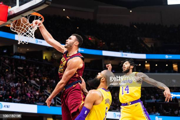 Larry Nance Jr #22 of the Cleveland Cavaliers dunks over Tyson Chandler and Brandon Ingram of the Los Angeles Lakers during the second half at...