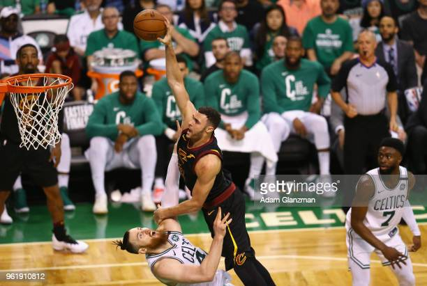 Larry Nance Jr #22 of the Cleveland Cavaliers dunks the ball against Aron Baynes of the Boston Celtics in the second half during Game Five of the...