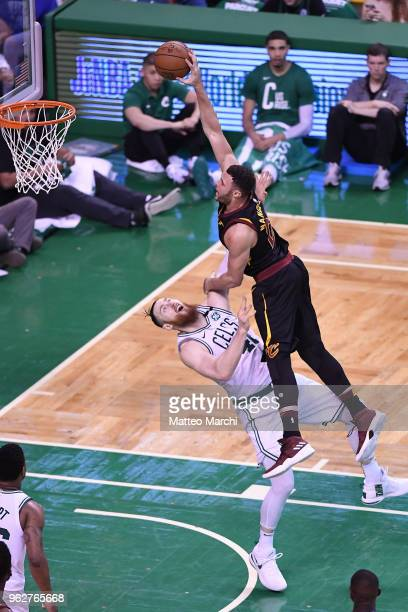 Larry Nance Jr #22 of the Cleveland Cavaliers dunks the ball against Aron Baynes of the Boston Celtics during Game Five of the 2018 NBA Eastern...