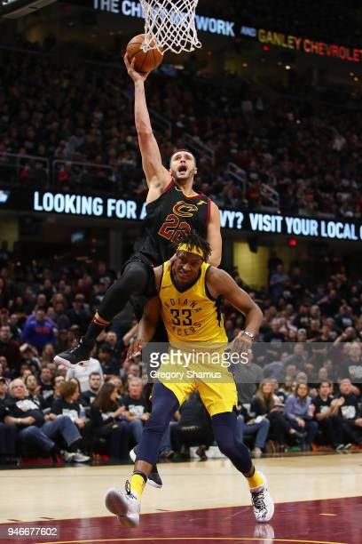 Larry Nance Jr #22 of the Cleveland Cavaliers gets to the basket over Myles Turner of the Indiana Pacers during the second half in Game One of the...
