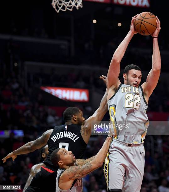 Larry Nance Jr #22 of the Cleveland Cavaliers grabs a rebound in front of Sindarius Thornwell of the LA Clippers and George Hill during the first...