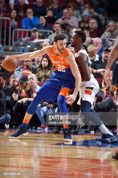 Larry Nance Jr #22 of the Cleveland Cavaliers handles the ball against Julius Randle of the New Orleans Pelicans on January 5 2019 at Quicken Loans...