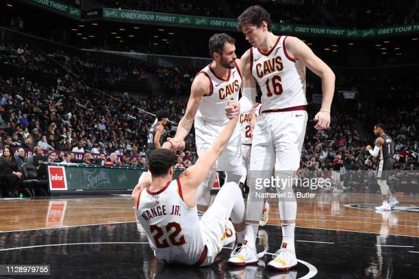 Larry Nance Jr #22 of the Cleveland Cavaliers helped to feet by teammates against the Brooklyn Nets on March 6 2019 at Barclays Center in Brooklyn...
