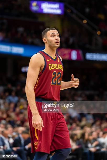 Larry Nance Jr #22 of the Cleveland Cavaliers talks with a teammate against the Brooklyn Nets during the first half at Quicken Loans Arena on...