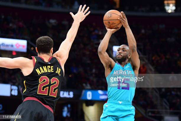 Larry Nance Jr #22 of the Cleveland Cavaliers tries to block Kemba Walker of the Charlotte Hornets during the first half at Rocket Mortgage...