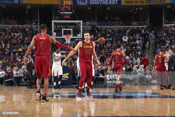 Larry Nance Jr #24 of the Cleveland Cavaliers high fives Rodney Hood of the Cleveland Cavaliers during the game against the Memphis Grizzlies on...