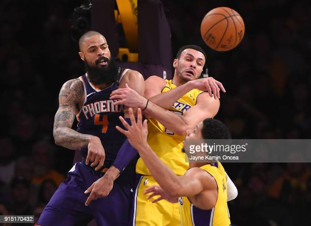 Larry Nance Jr #7 and Josh Hart of the Los Angeles Lakers battle Tyson Chandler of the Phoenix Suns for a rebound in the second half of the game at...