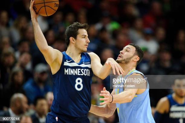 Larry Nance Jr #7 of the Los Angeles Lakers defends against Nemanja Bjelica of the Minnesota Timberwolves during the game on January 1 2018 at the...