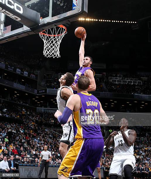 Larry Nance Jr #7 of the Los Angeles Lakers dunks during a game between the Los Angeles Lakers and the Brooklyn Nets on December 14 2016 at Barclays...