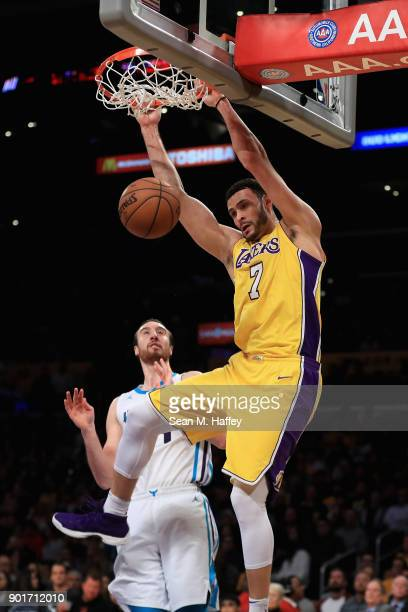 Larry Nance Jr #7 of the Los Angeles Lakers dunks past Frank Kaminsky of the Charlotte Hornets during the second half of a game at Staples Center on...