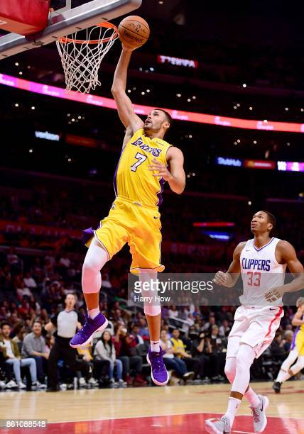 Larry Nance Jr #7 of the Los Angeles Lakers dunks past Wesley Johnson of the LA Clippers during the first half at Staples Center on October 10 2017...