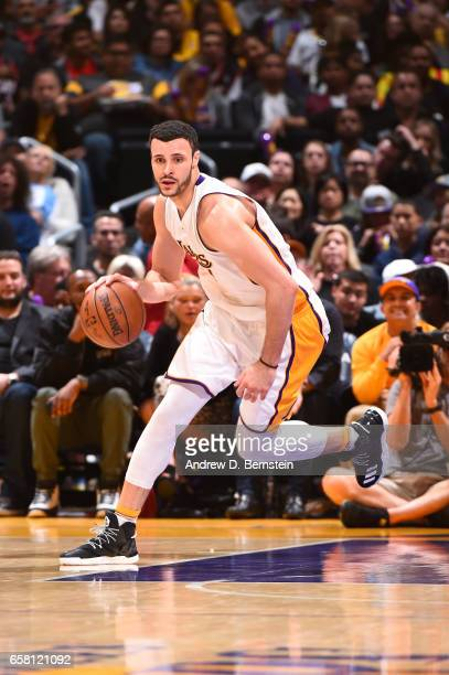 Larry Nance Jr #7 of the Los Angeles Lakers handles the ball against the Portland Trail Blazers on March 26 2017 at STAPLES Center in Los Angeles...