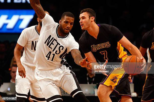 Larry Nance Jr #7 of the Los Angeles Lakers in action against Thomas Robinson of the Brooklyn Nets at Barclays Center on November 6 2015 in the...