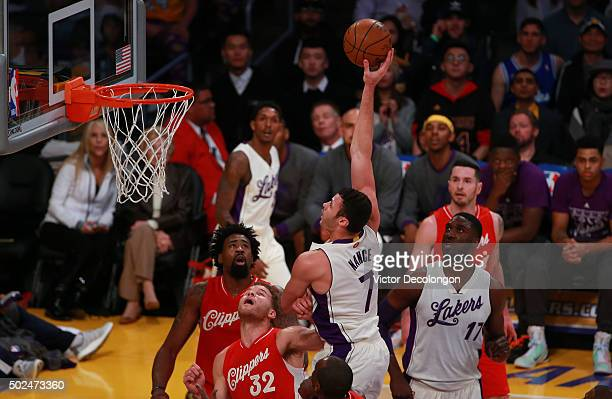 Larry Nance Jr #7 of the Los Angeles Lakers puts up a hook shot over Blake Griffin of the Los Angeles Clippers in the first half at Staples Center on...