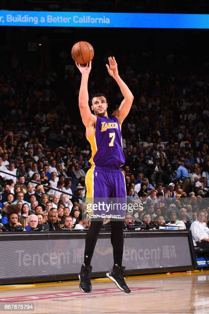 Larry Nance Jr #7 of the Los Angeles Lakers shoots the ball against the Golden State Warriors on April 12 2017 at ORACLE Arena in Oakland California...