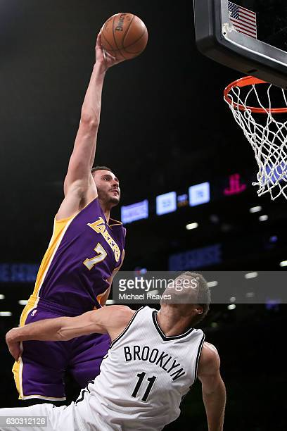 Larry Nance Jr #7 of the Los Angeles Lakers slams home a dunk over Brook Lopez of the Brooklyn Nets in the second half at Barclays Center on December...