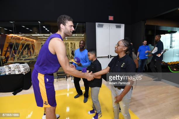 Larry Nance Jr introduces his pen pal former US Army specialist Bianca Campbell to Brook Lopez of the Los Angeles Lakers at UCLA Health Training...