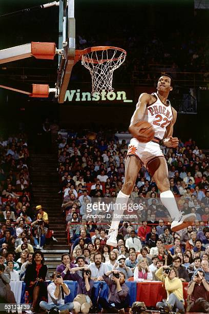 Larry Nance of the Phoenix Suns goes for a dunk in the 1984 NBA Slam Dunk Competition during the AllStar Weekend on January 28 1984 in Denver...