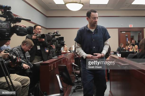 Larry Nassar appears in court to listen to victim impact statements prior to being sentenced after being accused of molesting about 100 girls while...